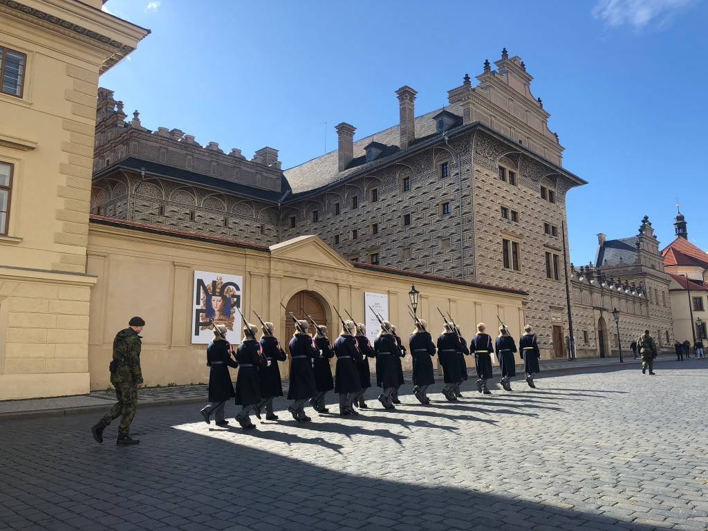 The changing of the guard at Prague Castle, which happens every hour on the hour. The best time to attend this ceremony is at noon when there's a ceremonial exchange of flags and a trumpet call.
